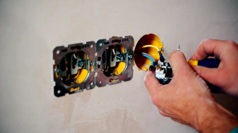 Electrician hands connect wiring of an electric socket Footage