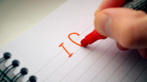 Hand writing I LOVE YOU U with red marker Live Action