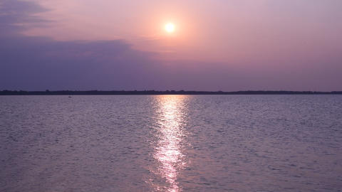 Sun shines over lake or river forming sun path on water Live Action