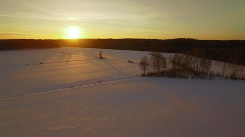 Landscape with crop fields covered by snow in winter during sunset Footage
