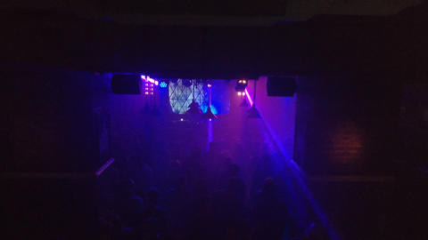 Smoky dance floor of an underground techno club with rays of light Footage