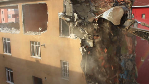 Demolition of a concrete building. An excavator using its bucket to tear down an Footage