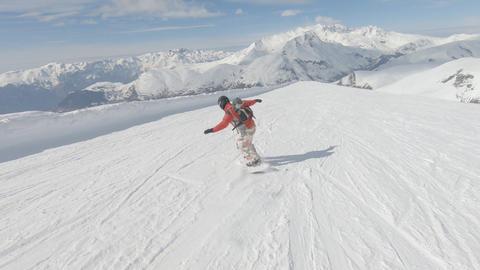 Snowboarder perform tricks Image