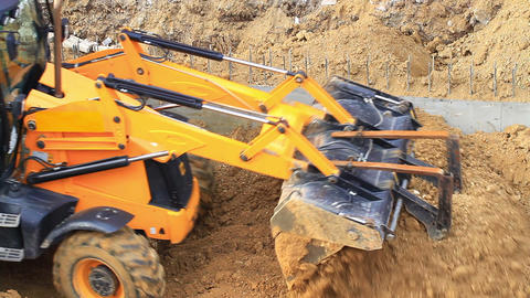 Pair of rubber tired backhoe excavator loader works for formation of land for Footage
