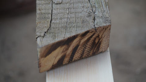 A wooden template is used to mark a wooden beam with a pencil Footage