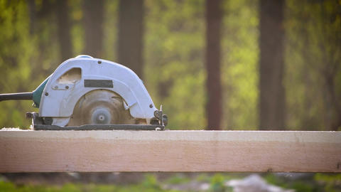 Sawing wooden beam lengthways with a circular hand saw Footage