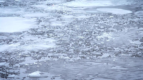 Thaw. Pieces, blocks and floes of melting ice float on water Footage