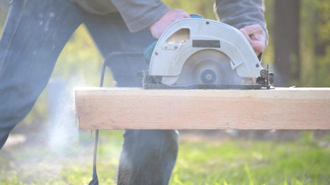 Sawing wooden beam with a blunt, not sharp circular hand saw Footage