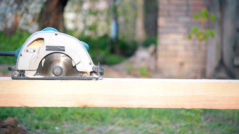 Sawing wooden beam with circular hand saw Footage