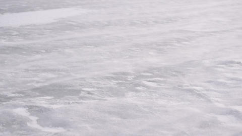 Drift snow on ice in winter blown by heavy wind Stock Video Footage