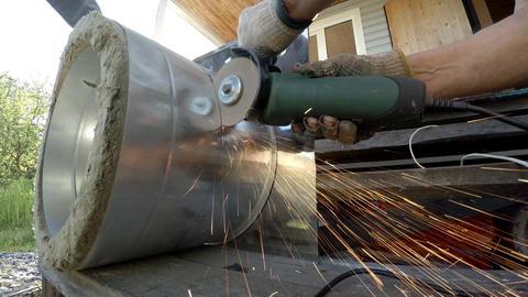 A worker saws a bulgarian metal. Circular saw. 4K Footage