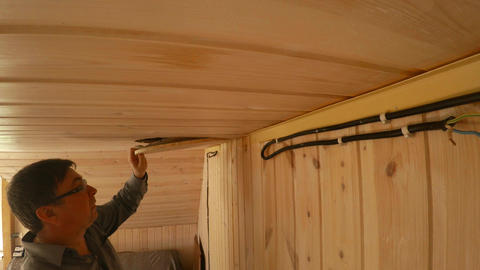 The carpenter is repairing the wooden ceiling. 4K Live Action