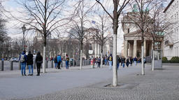 Tourists At Brandenburg Gate With Reichstag In Background In Berlin, Germany Footage