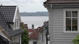Norway Skuteviken of Bergen view through houses at hillside to fjord Footage
