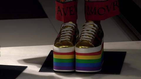 Shoes - a rainbow on a high platform. 4K Footage