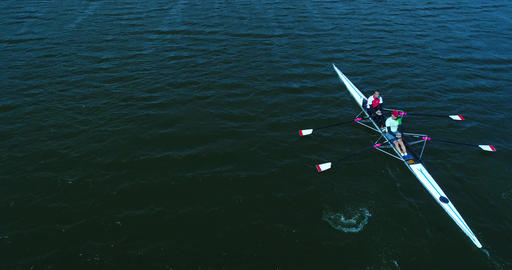 Two Men Row In Kayak By Wavy Water Surface At Sunny Day. Aerial Shot Of Rowers Footage