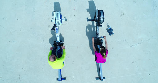 Aerial Shot Of Woman And Man Working Out On Rowing Machine Footage