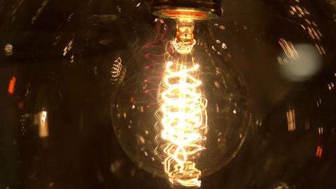 Old incandescent lamp. 4K Footage