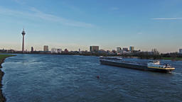 Duesseldorf / Germany - April 06 2018 : Canoe driving on the river Rhine 영상물