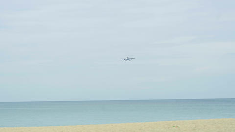 Widebody airplane approaching over ocean Live Action