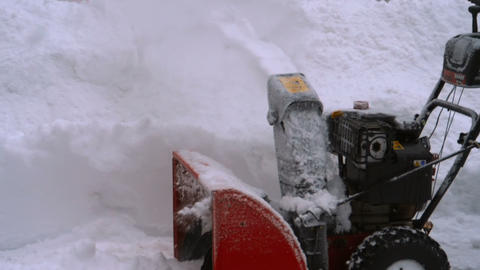 Man with a snow blowing machine working Footage