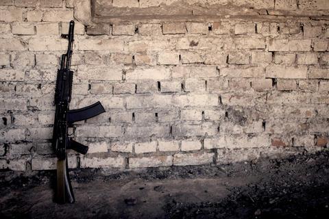 submachine gun kalashnikov AK-47 against the wall Photo