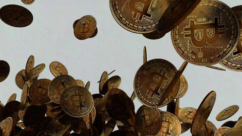 Large amount of Bitcoins falling down in real time Stock Video Footage