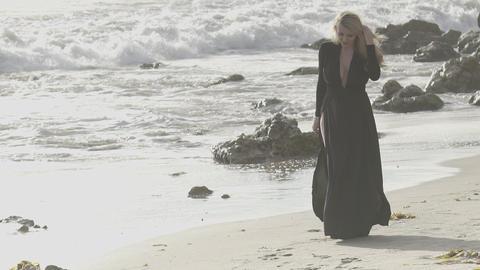 Woman with long blonde walking away Image