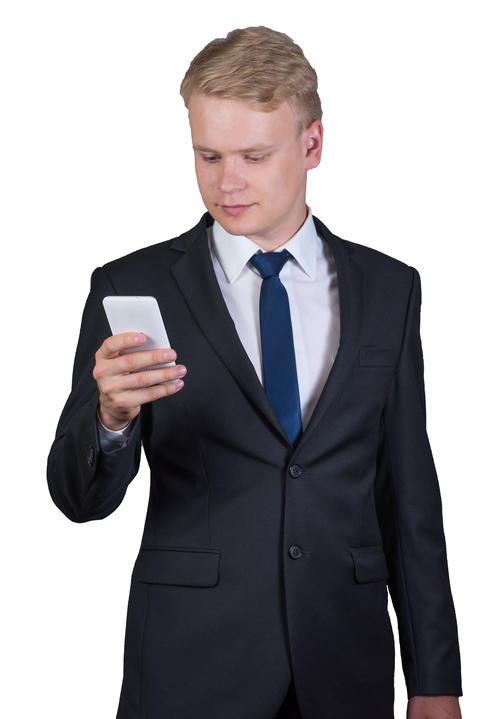 young businessman holding a mobile phone isolated on white background Fotografía
