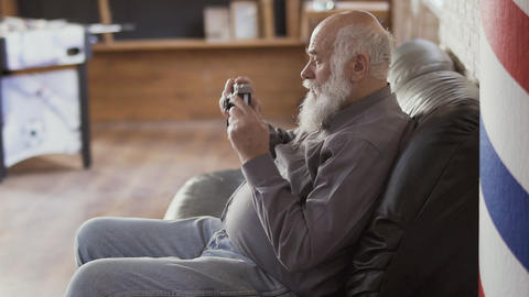 Handsome mature man makes photo with an old camera Footage