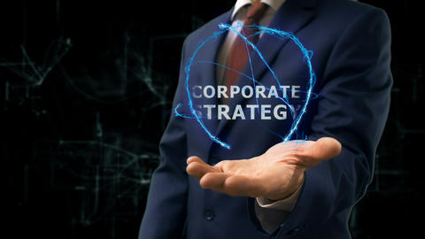 Businessman shows concept hologram Corporate strategy on his hand Footage