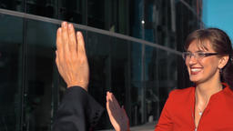 Business people high five outdoor Archivo
