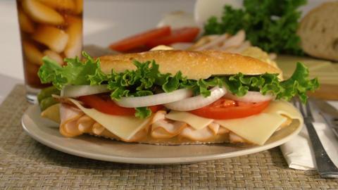 Sandwich Falling Onto A Plate In Slow Motion Footage