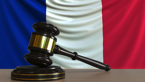 Judge's gavel and block against the flag of France. French court conceptual Footage