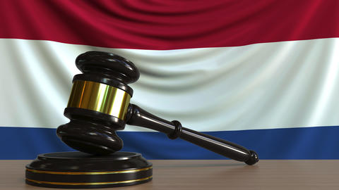 Judge's gavel and block against the flag of the Netherlands. Dutch court Footage