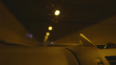 Car driving through a tunnel in slow motion Footage