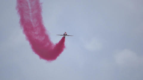 Red Arrows Slow Motion head on, with red smoke Live Action