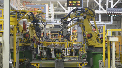 Automobile plant, industrial robots on the automatic assembly line 영상물