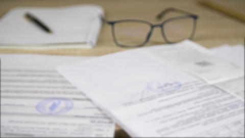 Professional business documents and papers, glasses, pen and copybook Live Action