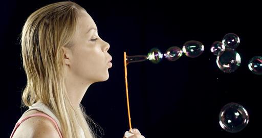 Pretty Woman Blowing Bubbles Footage