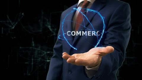 Businessman shows concept hologram E-commerce on his hand Live Action