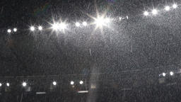 Snow falls over stadium lights Archivo