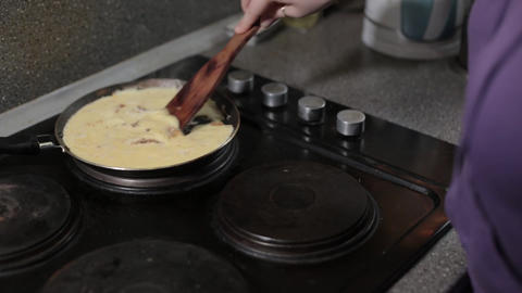 omelet, shaked eggs, food, cooking, kitchen, pan,european woman pours shaked Footage