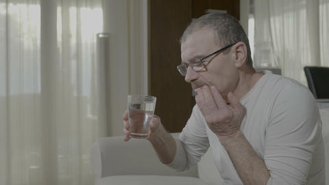 Elderly man having terrible sensitive toothache while he drink cold water Footage