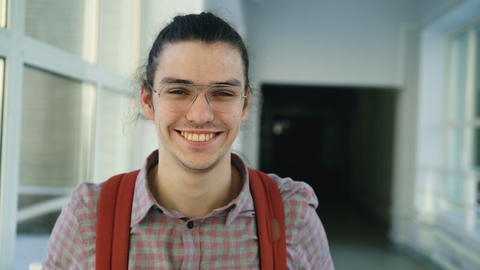 Portrait of young handsome attractive male student of caucasian ethnicity Footage