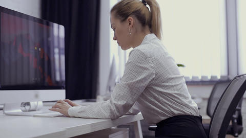 Businesswoman has a pain in shoulder during working on computer in the office Footage