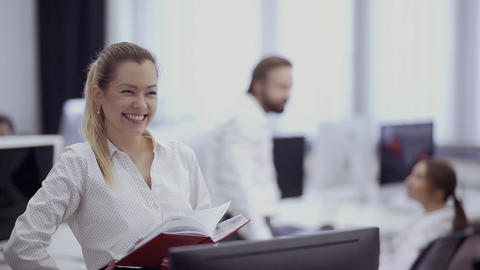 Beautiful smiling businesswoman in the office Footage