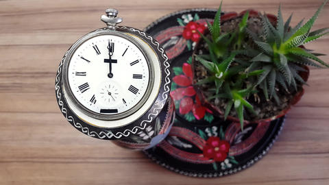 Clock In Flower Against The Background Of A Wooden Wall Image