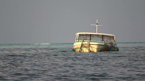 Indian Ocean, dark sky and white boat. Maldives video Archivo