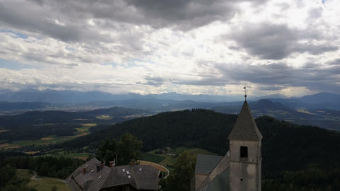 Flight above Ancient church on a mountain. AERIAL view of Magdalensberg Footage